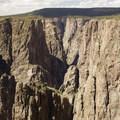 The steep quartz monzonite cliffs of the Black Canyon of the Gunnison.- North Rim Road