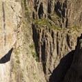 The quartz monzonite cliffs of the Black Canyon of the Gunnison.- North Rim Road