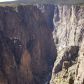 Looking west along the Black Canyon of the Gunnison and its quartz monzonite cliffs.- North Rim Road