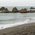Remainders of old rocks sit just offshore.- Wilson Creek Beach + Picnic Area