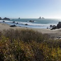 Panoramic view of the beach from the parking area.- Lone Ranch Beach + Picnic Area