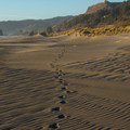 Footprints leading northward toward the northern section.- Pistol River Middle Beach