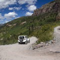 Hairpin turns and four-wheel drive vehicles frequent the trail to Bridal Veil Falls.- Bridal Veil Falls, Telluride