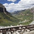 Views toward Telluride over an old mining railroad near the top of Bridal Veil Falls.- Bridal Veil Falls, Telluride