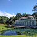 The boathouse makes a picturesque backdrop for this fisherman.- Prospect Park