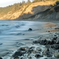 Waves retreat from the rocks on the southern end of this beach.- Agate Beach