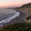 Day's last light over the entire beach.- Agate Beach