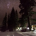 Pioneer Yurt at night, with the sauna on the far right.- Backcountry Skiing the Pioneer Yurt