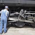 An operator greases the wheels of the Durango-Silverton Narrow Gauge Railroad.- Durango-Silverton Narrow Gauge Railroad