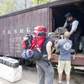 Unloading backpacks from the Durango-Silverton Narrow Gauge Railroad at the Needleton stop.- Durango-Silverton Narrow Gauge Railroad