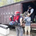 Unloading backpacks from the Durango-Silverton Narrow Gauge Railroad at the Needleton stop.- Durango-Silverton Narrow Gauge Railroad