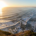 Panoramic view of sunset and Crescent Beach.- Crescent Beach Overlook