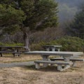 Several picnic tables sit here for a meal with a great view.- Crescent Beach Overlook