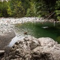 A small beach area at 30 Foot Pool in Lynn Canyon Park.- 30 Foot Pool, Lynn Canyon Park