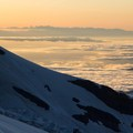Views northwest toward Puget Sound and the Olympic Mountains.- Mount Rainier: Emmons-Winthrop Glacier Route