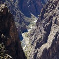 The Gunnison River at the base of the Black Canyon of the Gunnison, viewed from the Painted Wall Overlook.- South Rim Road