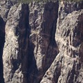 Cliffs of quartz monzonite at the Black Canyon of the Gunnison, viewed from the Painted Wall Overlook.- South Rim Road
