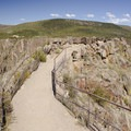 A short trail on a knife's edge, leading to the Pulpit Rock Overlook at Black Canyon of the Gunnison.- South Rim Road