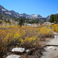 The lower portion of the trail traces the edge of the canyon valley.- Lamoille Lake