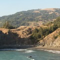 There is a hidden beach nearby that is difficult to access.- Arch Rock Viewpoint + Picnic Area