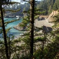 Secret Beach is nestled below the cliffs.- Thunder Rock Cove