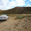 Parking beside the saturated marshy area near the springs. From here, walk toward the exposed rock at the bottom of the hillside.- Three-Mile Hot Spring