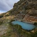 An emerald pool at the bottom of the hill.- Three-Mile Hot Spring