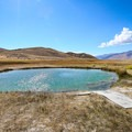 The main soaking spring at Ruby Valley Hot Springs offers incredible views of the surrounding mountains.- Ruby Valley Hot Springs