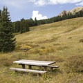 A picnic table at at Lizard Head Day Use Area.- Lizard Creek Day Use Area