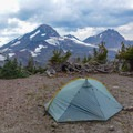 Off-trail camping with views to Middle and North Sister.- Three Sisters Loop