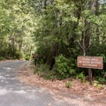 Parking area to paved access point.- Patrick's Creek Swim + Picnic Area