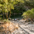 The downstream beach is rather large and provides cliff jumping access.- Sandy Beach
