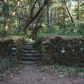 A stone foundation from a historic CCC building.- Patricks Creek Interpretive Trail