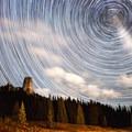 Star trails behind Chimney Rock.- Owls Creek Pass + Silver Jack Reservoir