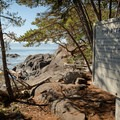 A sign on the trail will direct hikers down to the rocks where there are ancient petroglyphs.- Coast Trail: Aylard Farm to Beechey Head
