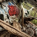 A mix of mangled metal and fallen trees.- Canso Plane Crash Hike