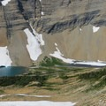 Glacier melt lakes at the base of the mountains.- Piegan + Siyeh Pass