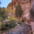 The creek passes beneath impressive canyon walls.- Kanarra Creek Trail to Kanarraville Falls