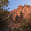 Sheer red rock cliffs hang overhead.- Kanarra Creek Trail to Kanarraville Falls