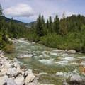 Flow check at the bridge. - Pack River: The Upper Slides, Middle Upper Pack