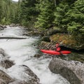 Maneuvering wood in one of the ledges.- Pack River: The Upper Slides, Middle Upper Pack