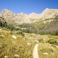 The trail leading to Twin Lakes and the Needle Mountains 14ers. From left: Mount Eolus (14,083 ft), Peak Eleven ( 13,546 ft), Needle Ridge, Sunlight Peak (14,059 ft), and Windom Peak (14,082 ft).- Windom Peak
