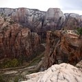 Standing on the brink of the main canyon with Angels Landing and the Great White Throne in the distance.- West Rim Trail, Lava Point to Zion Canyon