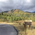 Summit Trailhead has multiple trails in all directions, including Alpine Summit to Elk Camp.- Alpine Loop Scenic Drive