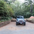 A few sites have elevated sites with stone steps.- Harris Beach State Park Campground