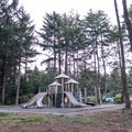 A large playground area sitting in the middle of the campground.- Harris Beach State Park Campground