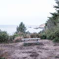 Bench at the very front of the campground.- Harris Beach State Park Campground