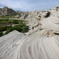 The trail leaves the valley floor, providing expansive views of the rock formations.- Bison Trail