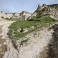 Leaving the prairie behind, the trail dives into fascinating rock formations.- Bison Trail