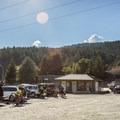 Parking lot featuring washroom facilities and a bike wash station.- Hartland Mountain Bike Trails